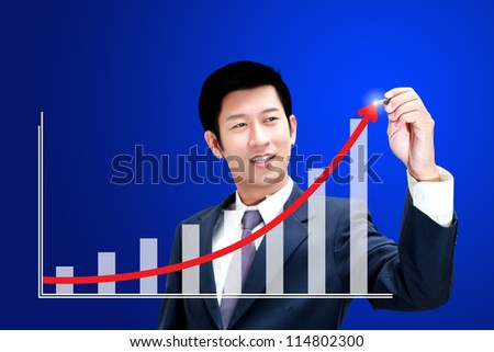 Asian business man drawing a graph of his business growth - stock photo
