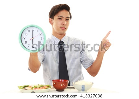 Asian business man eating meals - stock photo