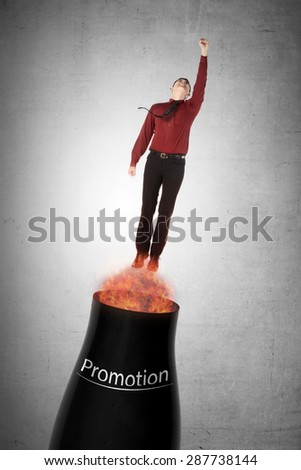 Asian business man flying from cannon. Quick promotion conceptual - stock photo