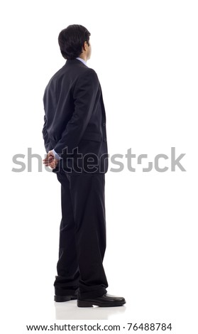 Asian business man from the back - looking at something over a white background