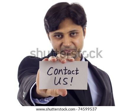 Asian business man holding a card- Contact Us! isolated over white background
