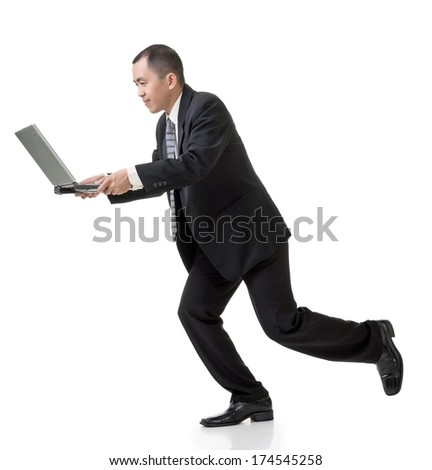 Asian business man holding laptop and running, full length isolated on white. - stock photo