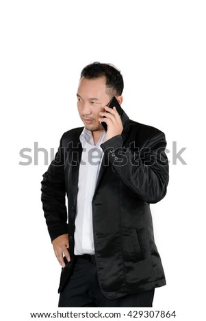 Asian business man in a suit talking on the mobile phone isolated on white background. - stock photo