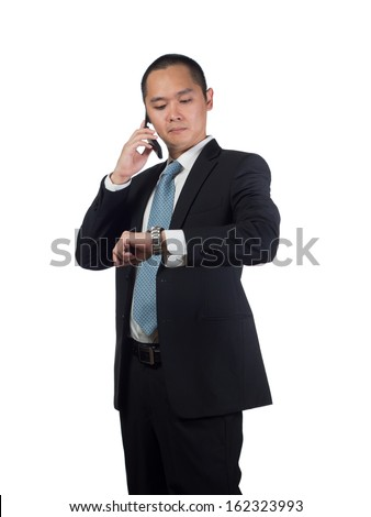 Asian business man is calling and checking time / watch at the same time. good analogy for appointment or waiting