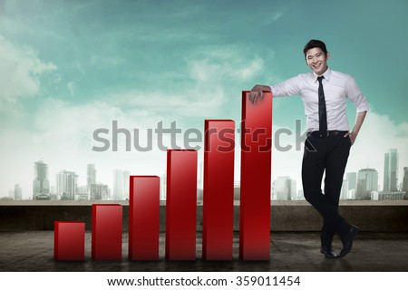 Asian business man leaning to increasing graph - stock photo