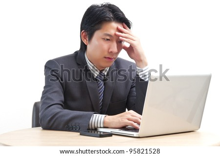 Asian business man looking depressed from work isolated on white background