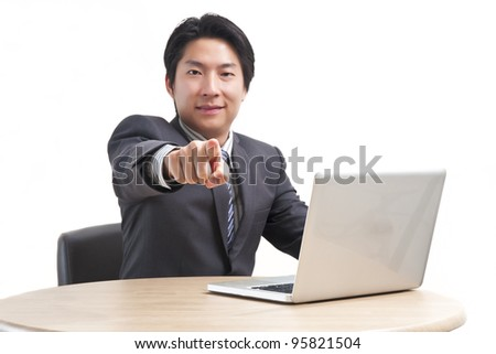 Asian business man pointing at you isolated on white background (Focus on hand) - stock photo