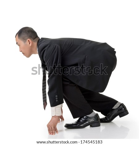 Asian business man prepare to race, full length isolated on white.