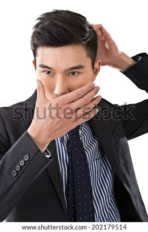 Asian business man put hands on face.