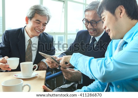 asian business man relaxing office life - stock photo