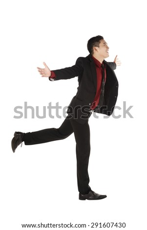 Asian business man running isolated over white background