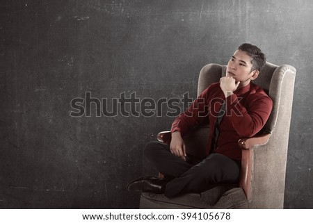 Asian business man seat on the chair thinking of something
