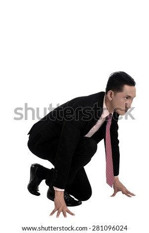 Asian business man start running isolated over white background - stock photo
