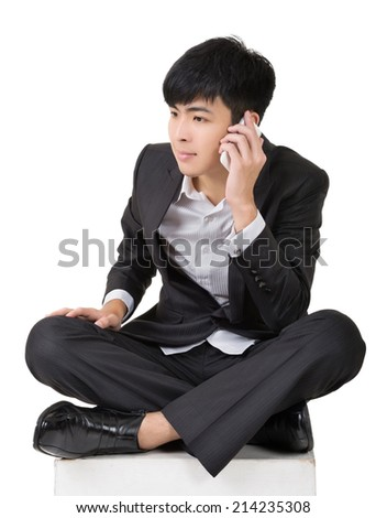 Asian business man take a call and sit on ground