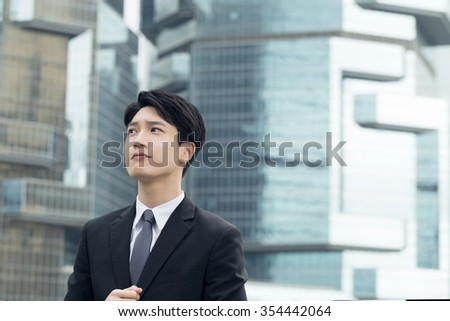 Asian business man thinking at the city. - stock photo