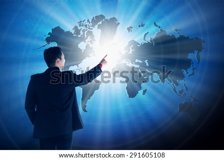 Asian business man touching world on virtual screen. Globalization business concept - stock photo
