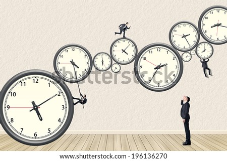 Asian business man try his best to do the time management. Photo compilation using the same model. - stock photo