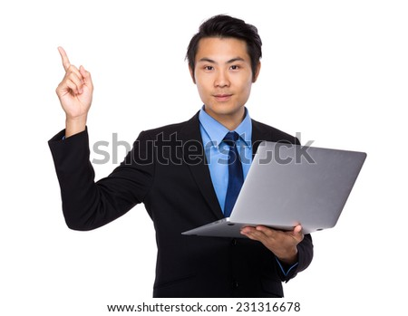 Asian Business man use of laptop and finger point up - stock photo