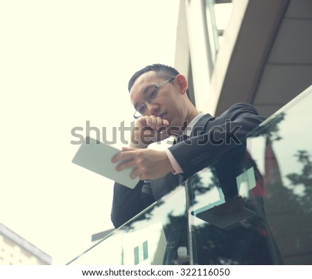 Asian Business man using a touch pad PC  - stock photo