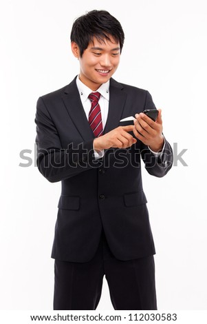 Asian business man with cellphone isolated on white background.