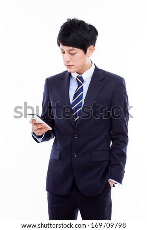 Asian business man with cellphone isolated on white background. - stock photo
