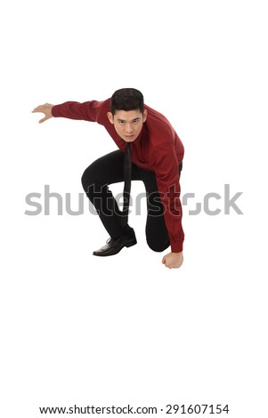 Asian business man with fighting gesture isolated over white background - stock photo