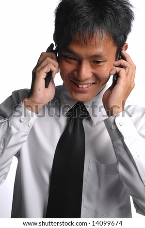 asian business man with multiple handphones