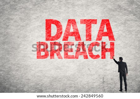 Asian business man write words on wall, Data Breach - stock photo