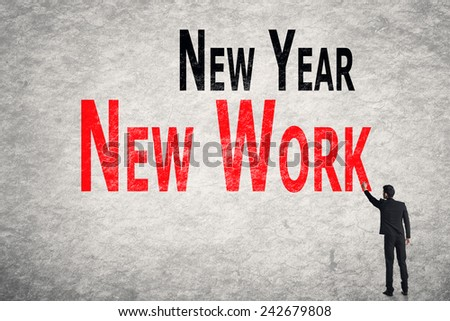 Asian business man write words on wall, New Year New Work - stock photo