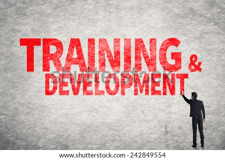 Asian business man write words on wall, Training & Development - stock photo