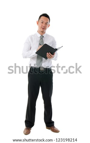 asian business man writing notes - stock photo