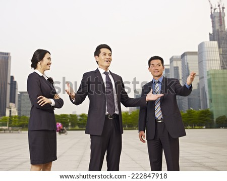 asian business people at construction site. - stock photo