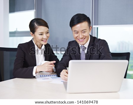 asian business people discussing business in office. - stock photo