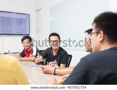 Asian business people group meeting room collaboration colleagues discussing conference desk real office team - stock photo