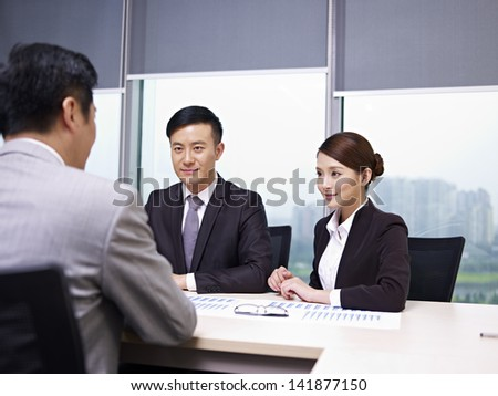 asian business people meeting in office - stock photo