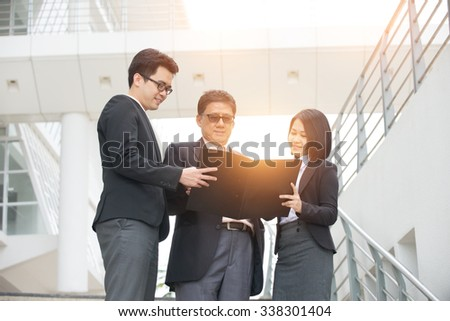 asian business people outdoor - stock photo