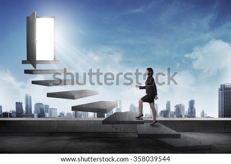 Asian business person going up to the door using stair. Business career conceptual - stock photo