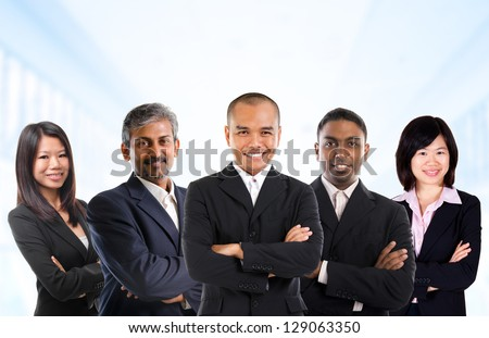 Asian business person in multiracial. Diversity business people form by different races, Indian, Malay, Indonesian, Chinese standing in office environment. - stock photo