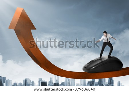 Asian business person surfing with computer mouse