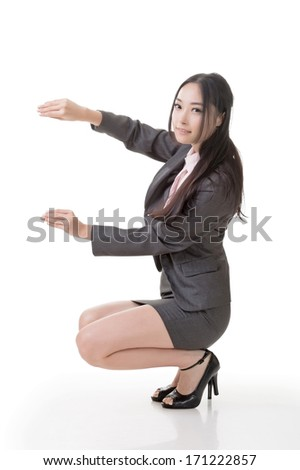 Asian business pose of hold something like paper, board by hand, full length portrait isolated on white background.