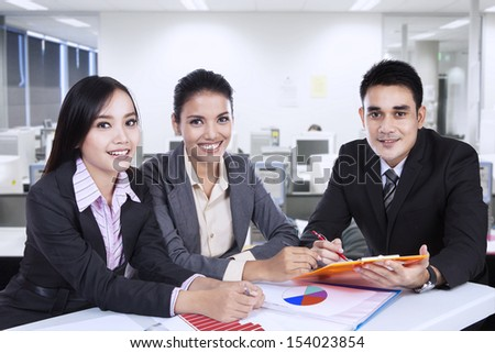 Asian business team at a meeting in office - stock photo