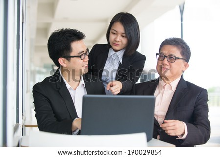 asian business team in a restaurant meeting - stock photo