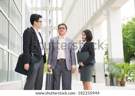 asian business team in office background