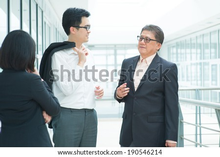 Asian business team meeting. Group of businesspeople having discussion over office. Boss and staffs. - stock photo