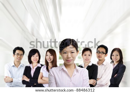 Asian business team on office background - stock photo