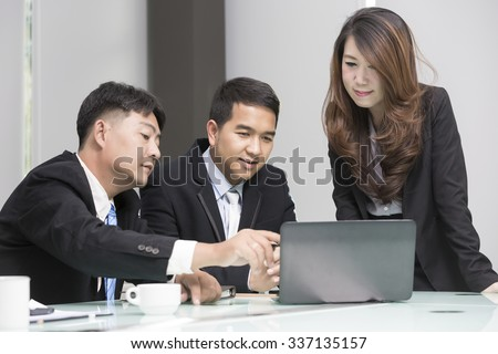 Asian business, technology and office concept - strict female boss talking to business team.