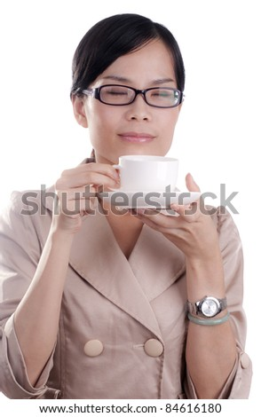Asian business woman about to enjoy her morning cup of coffee before work isolated - stock photo