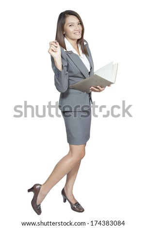 Asian Business woman attractive young pretty in office standing enjoy using a pen writing diary note book smiling positive on white background