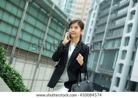 Asian business woman chat on mobile phone