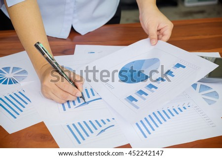 Asian Business woman discussion and analysis data at meeting